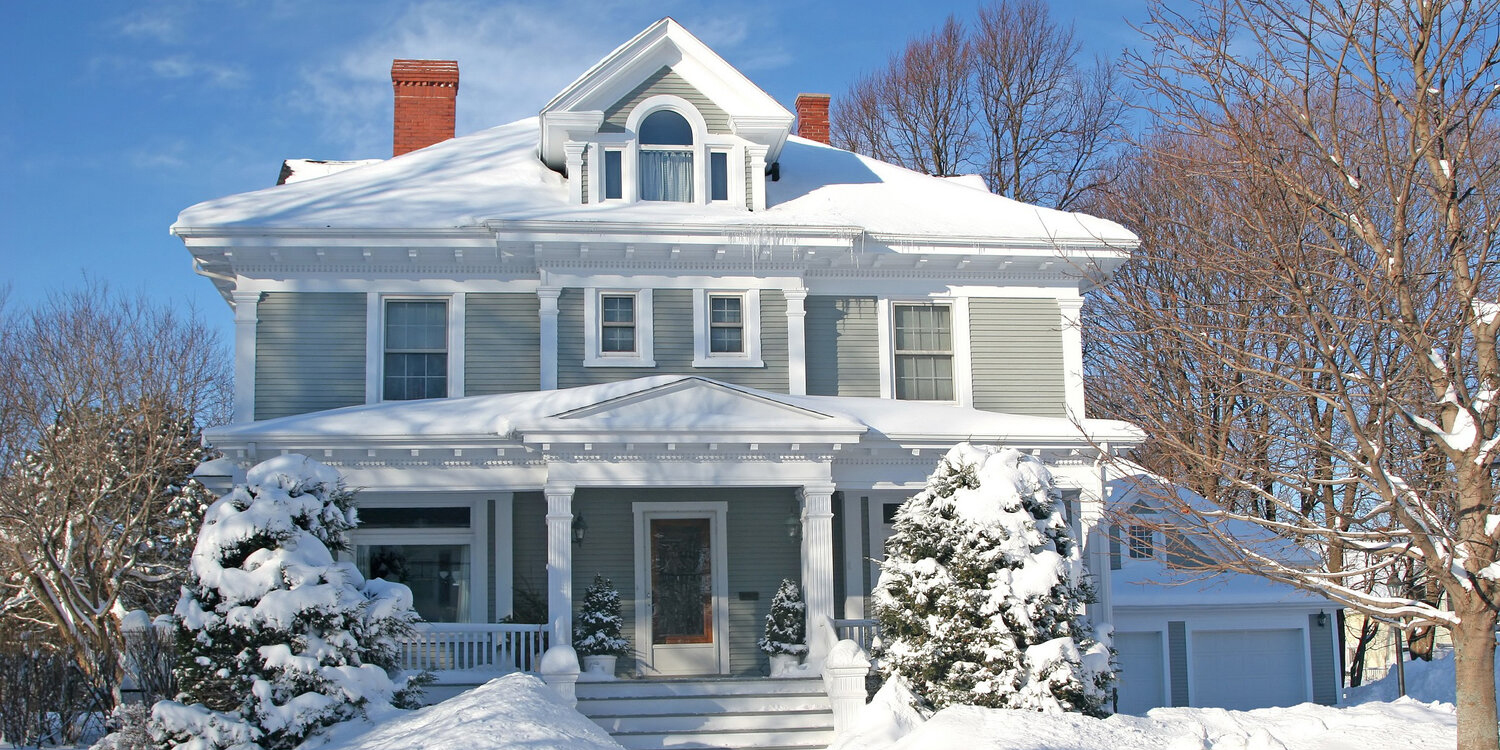 Photo of home covered with snow